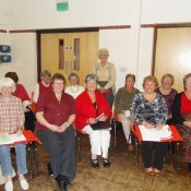 The village choir prepare to entertain guests